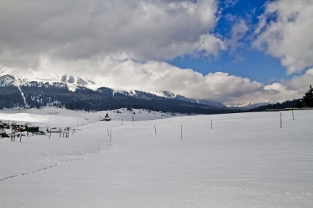 Clouds over a snow covered landscape, Kashmir, Jammu and Kashmir, India Stock Photo