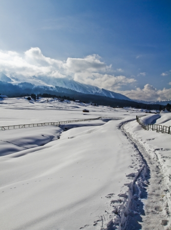 Snow covered landscape with mountain range , Kashmir, Jammu And Kashmir, India