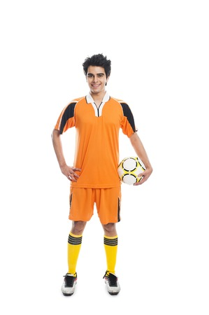 Portrait of a soccer player holding a soccer ball and smiling photo