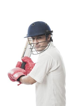 Batsman playing cricket photo