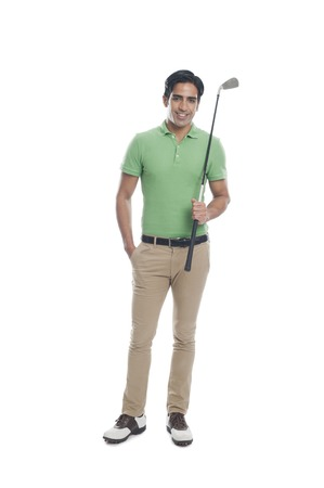 Male golfer holding a golf club and smiling photo