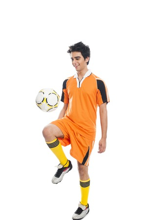 sportsperson: Soccer player practicing with a soccer ball