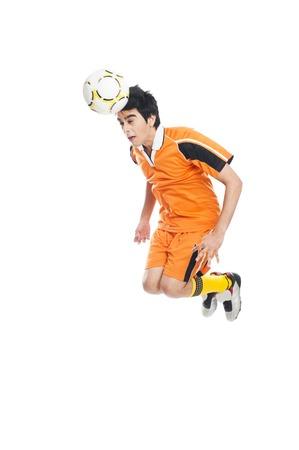 sportsperson: Soccer player heading a soccer ball