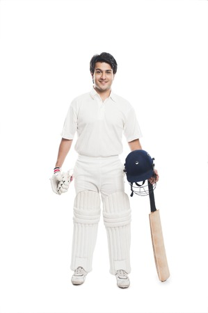 cricket bat: Batsman holding a cricket bat with sports helmet and smiling Stock Photo