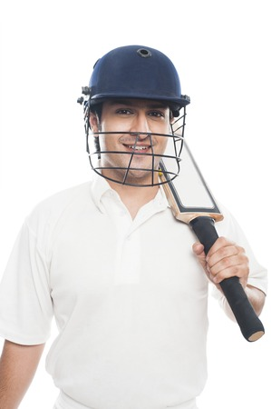 cricket bat: Portrait of a batsman with holding a cricket bat and smiling Stock Photo