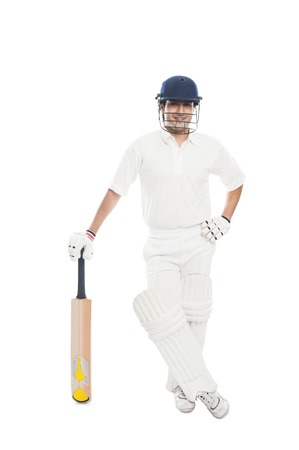 Portrait of a batsman standing with a cricket bat photo