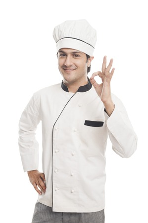 Portrait of a male chef showing ok sign and smiling photo