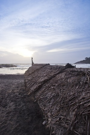 thatched roof: Thatched roof huts on the beach, Kovalam, Kerala, India