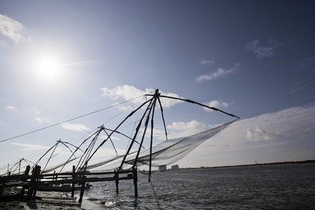 chinese fishing nets: Chinese fishing nets at a harbor, Cochin, Kerala, India