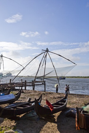 Chinese fishing nets and boats on the beach, Cochin, Kerala, India Stock Photo - 25620372