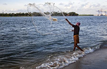 Fisherman fishing in the sea, Cochin, Kerala, India