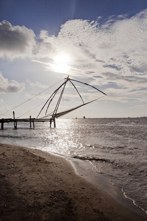 chinese fishing nets: Chinese fishing nets on the beach, Cochin, Kerala, India