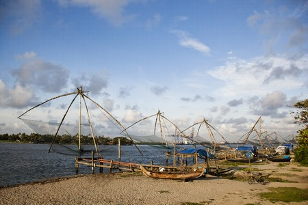 chinese fishing nets: Chinese fishing nets and boats on the beach, Cochin, Kerala, India