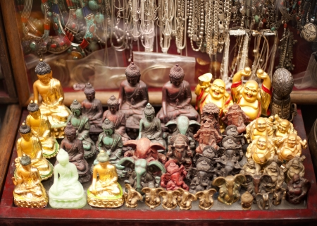 buddha image: Figurines of Buddha for sale at souvenir shop, Tibetan Market, Delhi, India