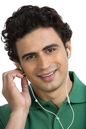 Portrait of a man listening to music on a mobile phone and smiling photo