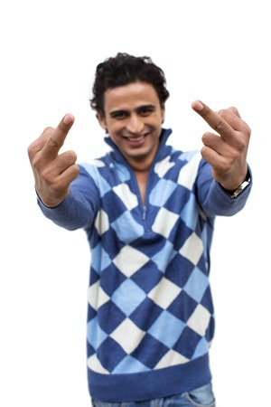 human finger: Portrait of a smiling man showing middle fingers