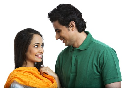 Couple looking at each other and smiling Stock Photo