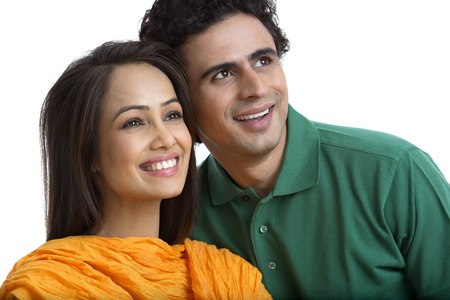 Close-up of a couple smiling photo