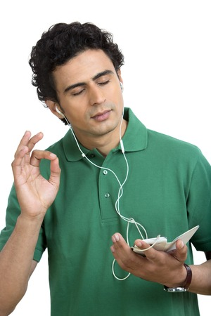 Man listening to music on a mobile phone with his eyes closed photo