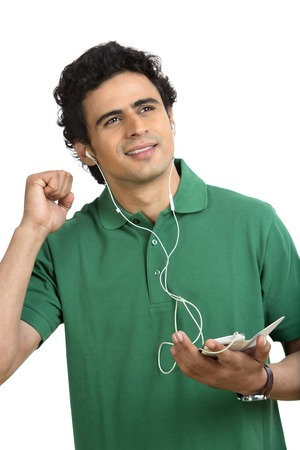 Man listening to music on a mobile phone photo
