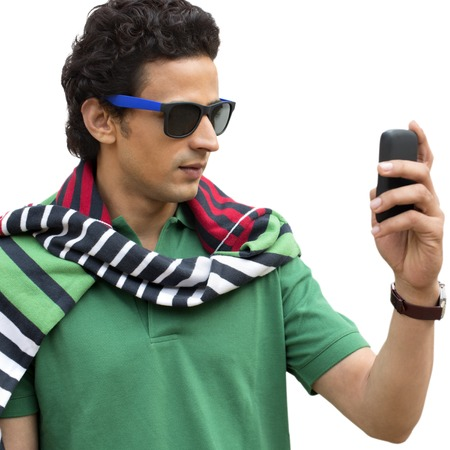 clipping  messaging: Man text messaging on a mobile phone Stock Photo