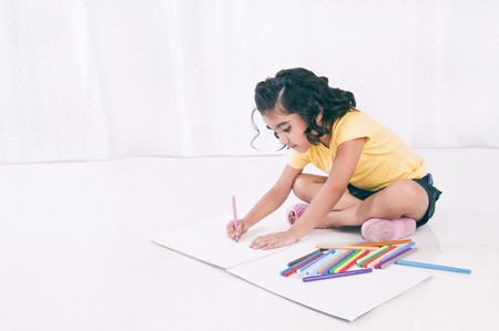 Girl making a drawing Stock Photo