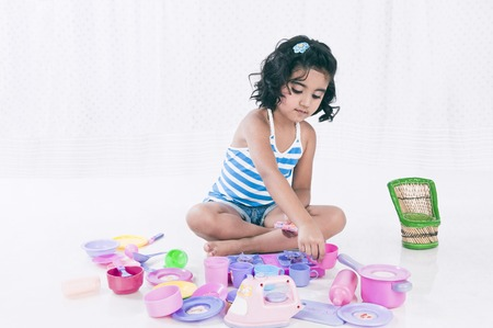 Girl playing with toys photo