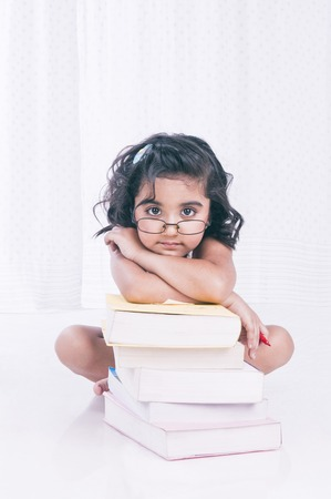 Portrait of a girl leaning on books