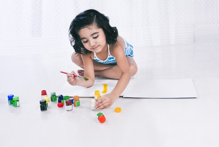 Girl painting with water colors Stock Photo