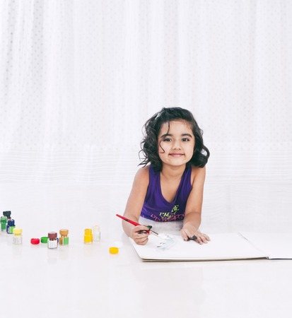 Portrait of a girl painting photo