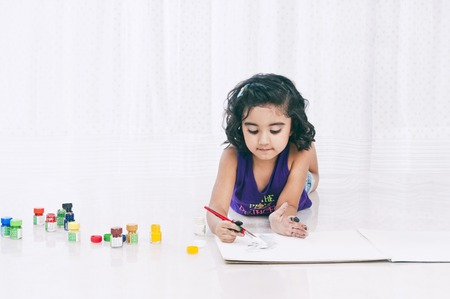 children painting: Girl painting with water colors Stock Photo