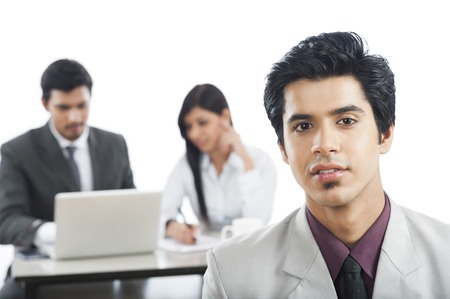 Portrait of a businessman with his colleagues in the background photo