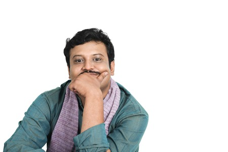 kurta: Portrait of a man with his hand on his chin Stock Photo