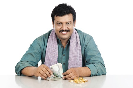 Portrait of a man counting money and smiling photo