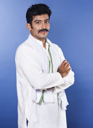 kurta: Portrait of a man standing with his arms crossed Stock Photo