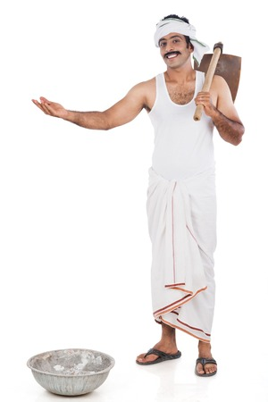 dhoti: Portrait of a farmer carrying spade o his shoulders and gesturing