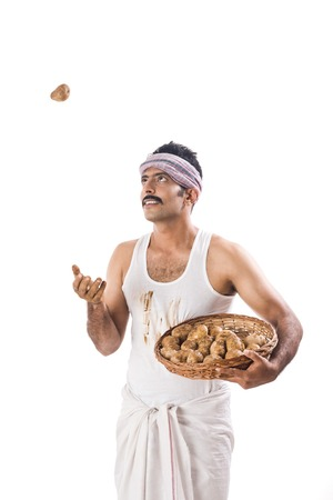 tossing: Farmer tossing a potato