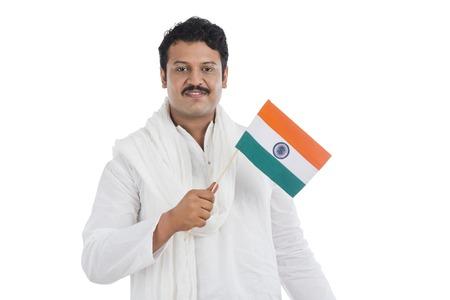 kurta: Portrait of a man holding national flag of India