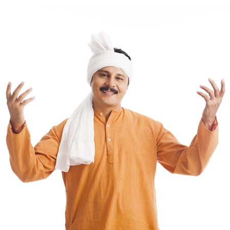 kurta: Portrait of a man gesturing and smiling Stock Photo