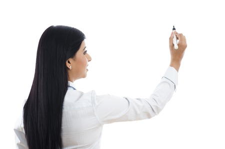 Businesswoman writing with felt tip pen