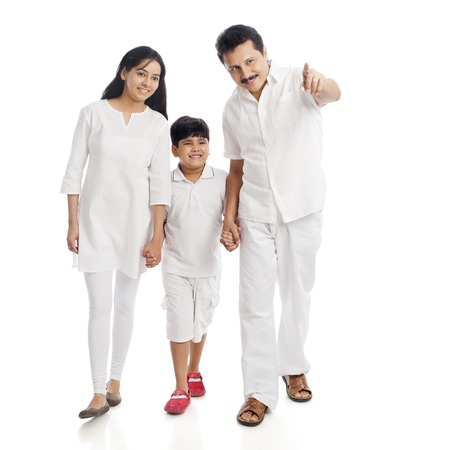 Smiling couple with their son photo
