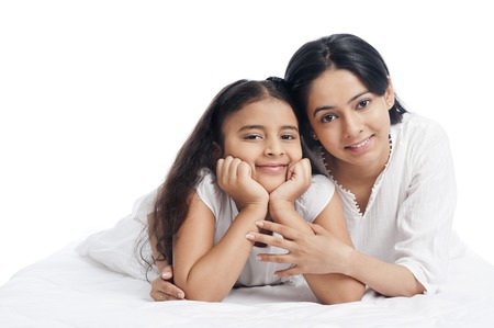 one family: Portrait of a woman smiling with her daughter Stock Photo