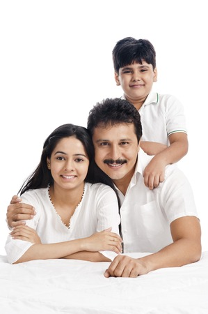 Portrait of a smiling boy with his parents photo