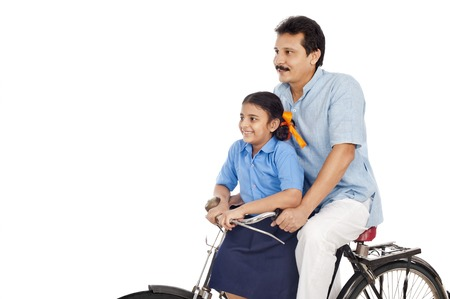 kurta: Man with his daughter on a bicycle