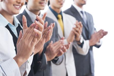 Business executives applauding
