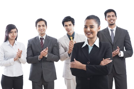 Portrait of business executives smiling and applauding photo