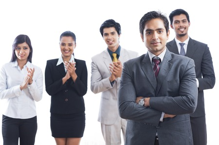 Portrait of business executives smiling and applauding