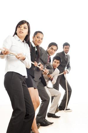 Business executives playing tug-of-war
