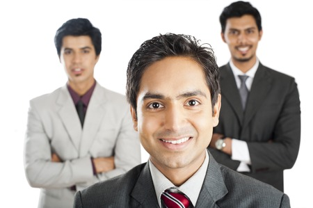 three persons only: Portrait of a businessman smiling with his colleagues in the background
