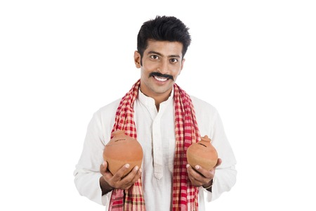 kurta: Portrait of a man carrying piggy bank in both hands Stock Photo